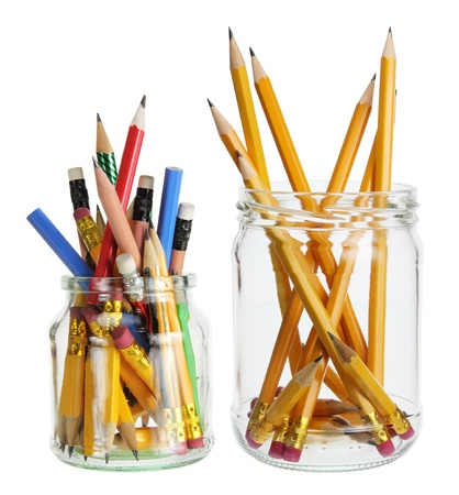 writing implements: Pencils in Glass Jars on White Background