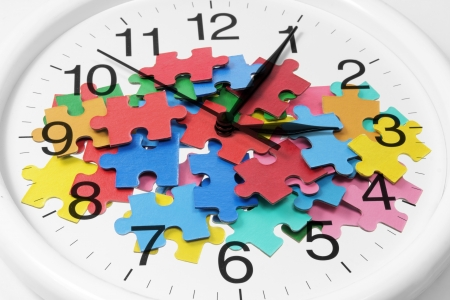 interlink: Composite of Clock and Puzzle Pieces Stock Photo