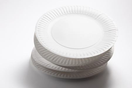 Stack of Paper Plates on Seamless Background