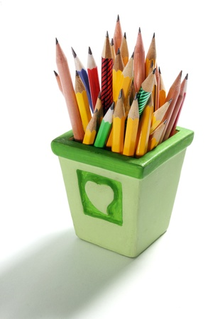 writing implements: Pencils in Container on White Background Stock Photo