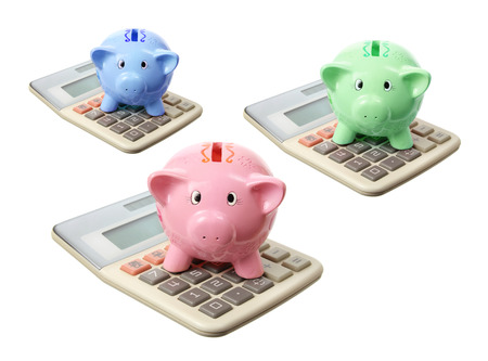 color key: Piggybanks and Calculators on White Background Stock Photo