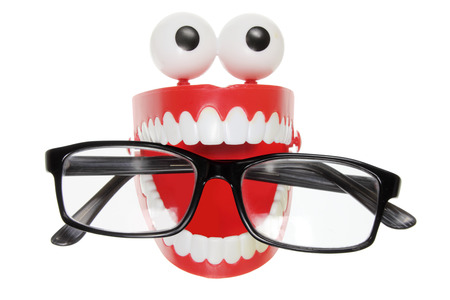 Chattering Teeth with Eyeglasses on White Background photo