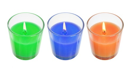 Candles in Glasses on White Background