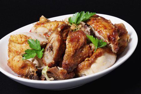 pollos asados: Chinese Roast Chicken on Black Background
