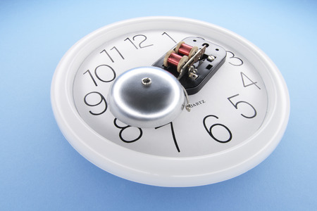 precisely: Alarm Bell on Wall Clock