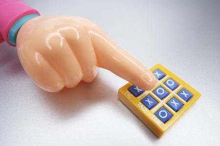 toe: Plastic Hand  and Tic Tac Toe Game