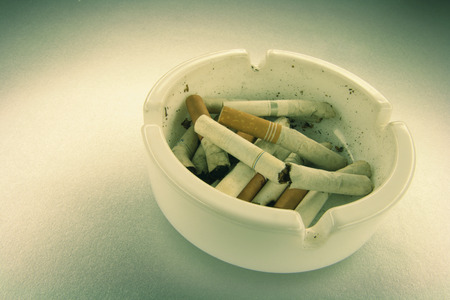 ashtray: Cigarette Butts on Ashtray Stock Photo