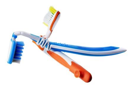 overuse: Broken Toothbrushes on White Background Stock Photo