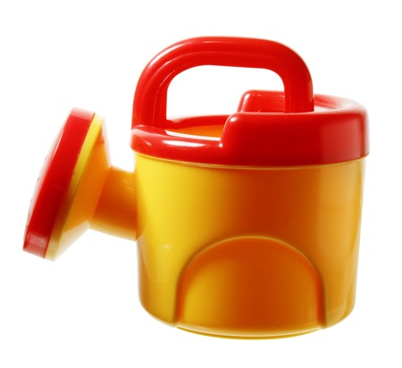 water conservation: Toy Watering Can on White Background