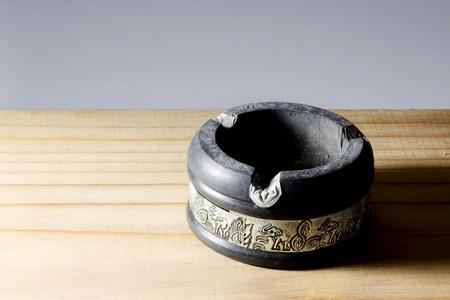 ashtray: Ashtray on wooden background
