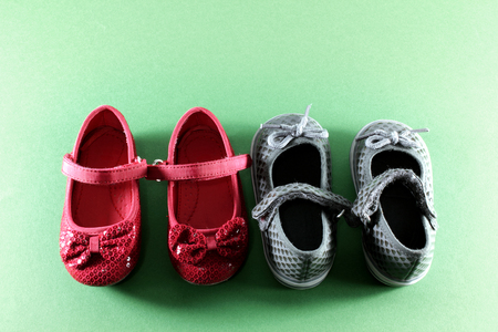 foot gear: Baby Shoes on Green Background