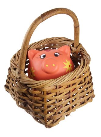 thrifty: Piggybank and Basket on White Background Stock Photo