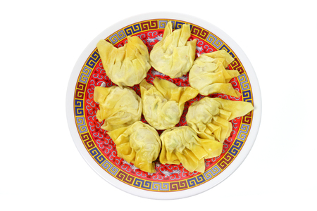 potstickers: Plate of Chinese Dumplings on White Background