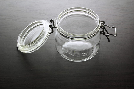 airtight: Glass Jar on Wooden Background Stock Photo