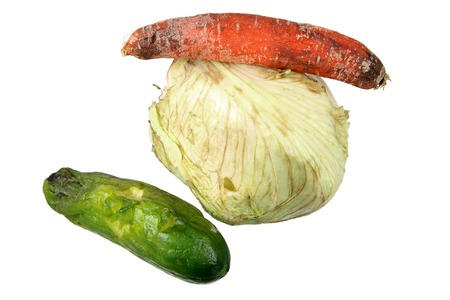 perishable: Rotten Vegetables on White Background Stock Photo
