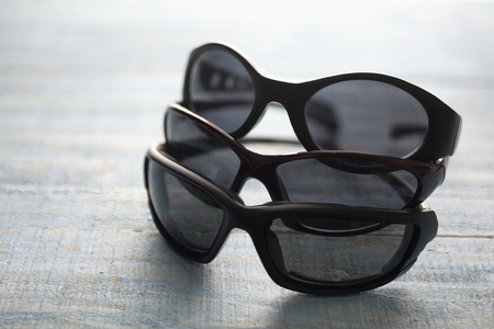 Sunglasses on Wooden Background