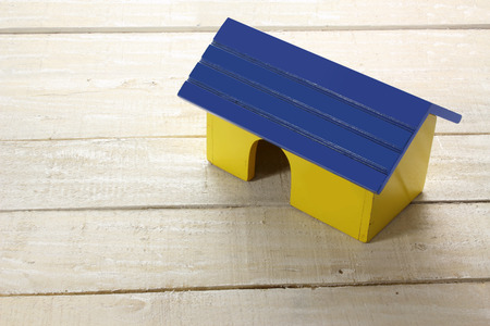 toy house: Toy House on Wooden Background