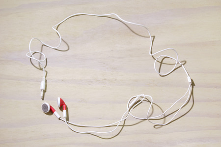 earphone: Earphone on Wooden Background