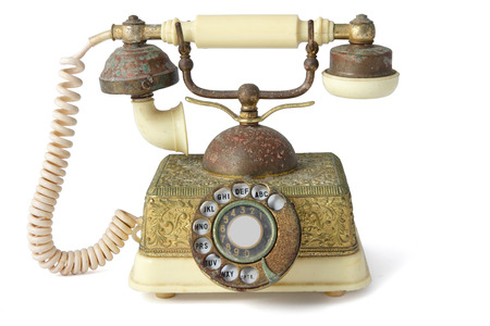 phone cord: Antique Telephone on White Background