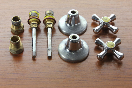 Taps on Wooden Background Stock Photo