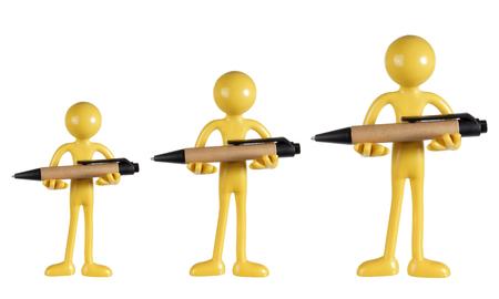 ball pens stationery: Figuras sosteniendo bolígrafos sobre fondo blanco Foto de archivo