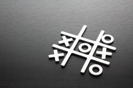 Tic Tac Toe on Wooden Background Banco de Imagens