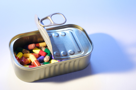 Pills in Tin Can on Seamless Background Stock fotó