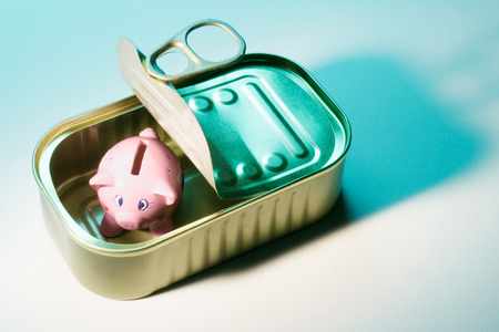 Piggybank in Tin Can on Seamless Background Stock fotó