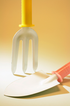pitching: Gardening Tools on Yellow Background