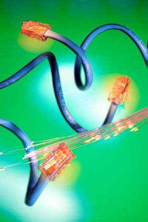 Network Cable and OPtical Fibres on Green Background