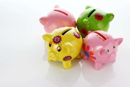 Piggy Banks on Seamless White Background
