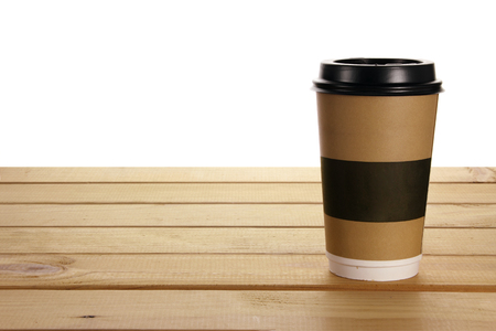 Paper Cup on Wooden Background
