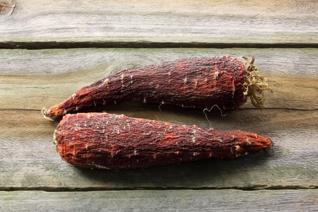 Rotten Carrots on Wooden Background