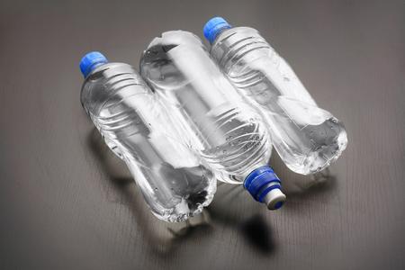 Water Bottles on Wooden Background