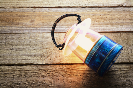Camping Lantern on Wooden Background