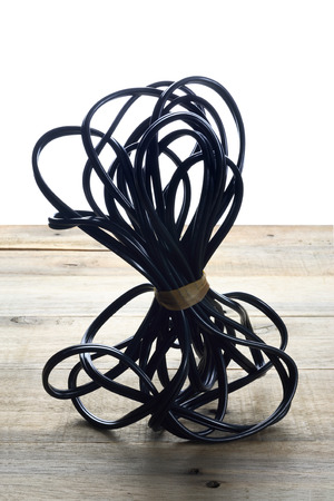 Wire on Wooden Background