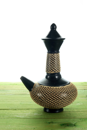 Arabic Coffee Pot on Wooden Background Stock Photo