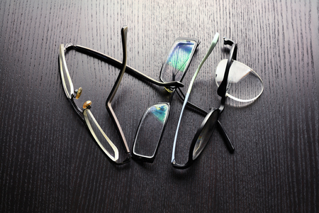 Broken Eyeglasses on Wooden Background