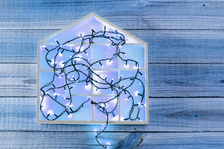 Fairy Lights and House Shape on Wooden Background Banque d'images