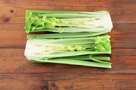 Halves of Celery on Wooden Background
