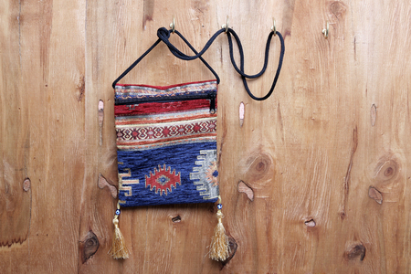 Sling Bag on Wooden Background Banque d'images