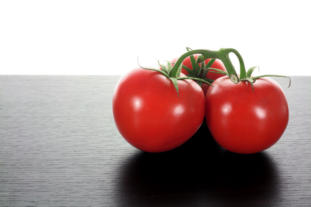 Bunch of Tomato on Wooden Background