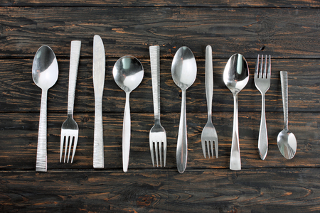Forks and Spoons on Wooden Background Banque d'images