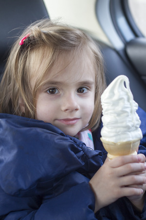 hair clip: little girl holding a ice cream cone wearing a dress and a hair clip