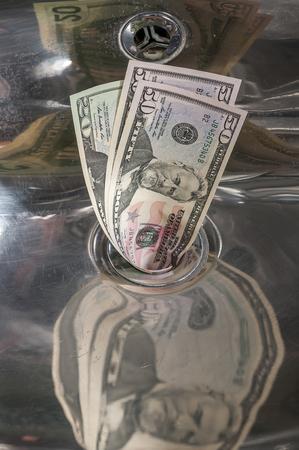 money matters: Money Down the Drain,business concept