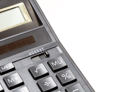algebra calculator: Detail of a calculator on a white background