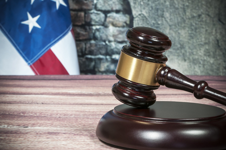 counsel: Gavel and USA flag on the background of the old wall