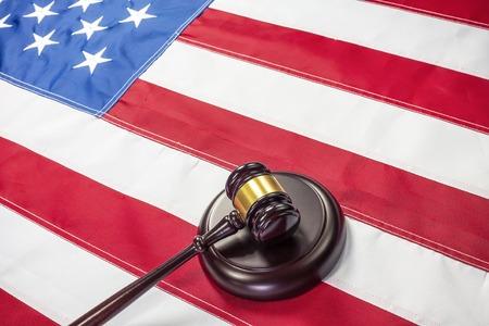 international criminal court: Gavel on the flag of US background Stock Photo