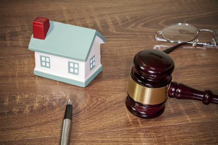 bidding: gavel on the table, gavel on a wooden table, wooden background