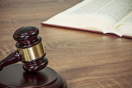 barrister: Judge gavel and old books on a wooden table
